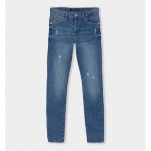 Jeans Skinny Roto denim medio
